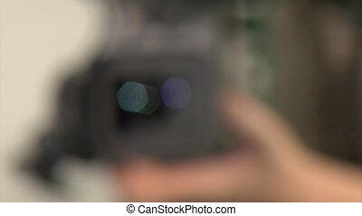 studio video shooting - cameraman adjusting the focus manual