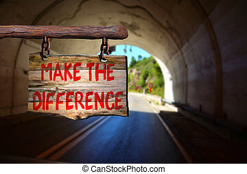 Make the difference motivational phrase sign on old wood...