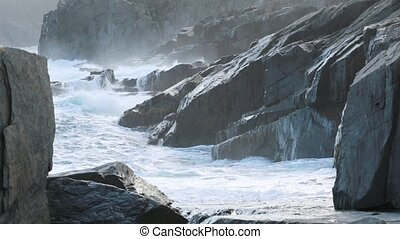 Waves crashing on shoreline - Waves breaking on the...