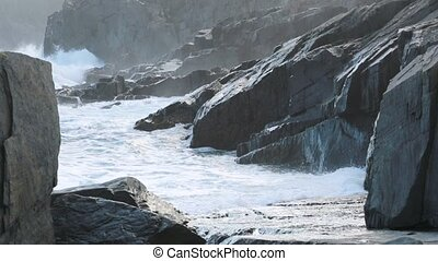 Waves breaking on the rocks - Waves breaking on the...