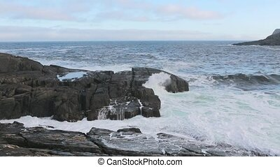 Waves flowing over rocks - Waves flowing over large rocks.