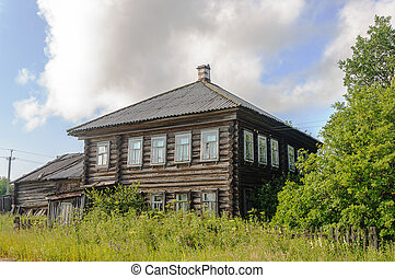Old two-storey log house in the country
