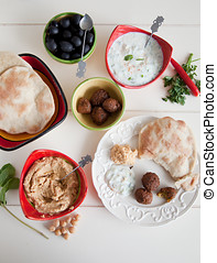 Mezze table - Delicious table filled with snack such as...