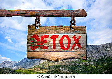 Detox motivational phrase sign on old wood with blurred...
