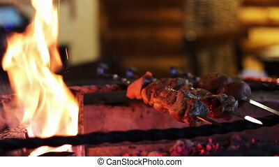 Kebab prepared on the grill in the restaurant - Shashlik on...