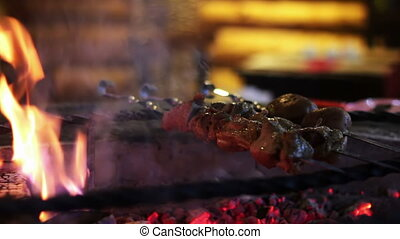Kebab prepared on the grill in the restaurant.