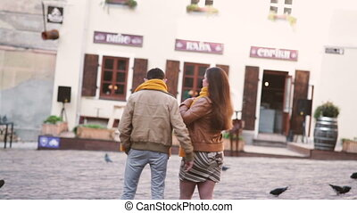 Young couple in love walking through the old city of Lviv