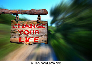Change your life motivational phrase sign on old wood with...