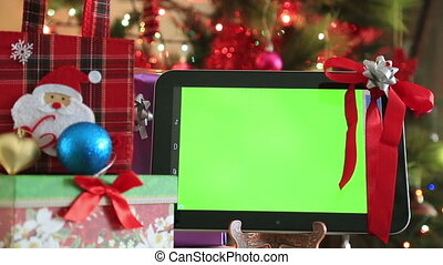 Green screen digital tablet with christmas tree lights...