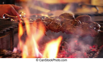 Kebab prepared on the grill in the restaurant. - Shashlik on...
