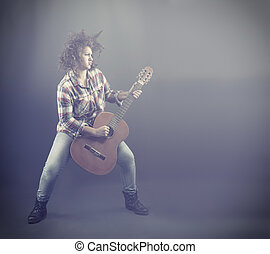 Rockstar - Teenager playing the classical guitar.