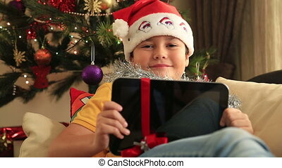 Child posing with Christmas gift