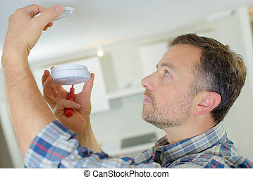 Fitting a smoke alarm to be safe