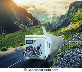Car-house in mountains - Car-house with mountain bikes on...