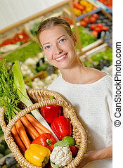 Woman using a wicker basket to carry her vegetables