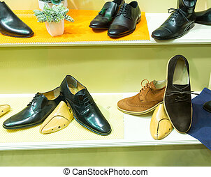 Man's shoes on the show case - Closeup of different man's...