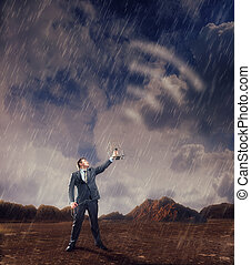 Businessman creating airwaves with antenna in storm