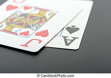 Black Jack closeup Two cards on grey background