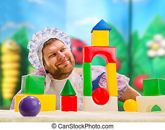 Man weared as baby play indoor - Man weared as baby playing...