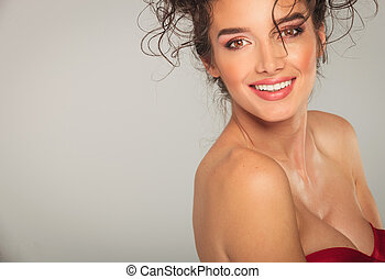 portrait of sexy woman in red dress posing at the camera -...