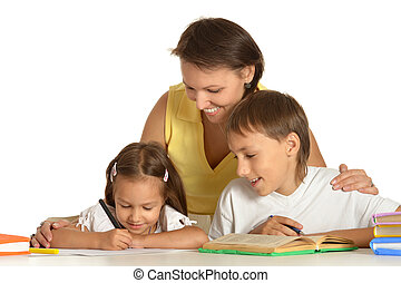 Mother doing homework with her kids