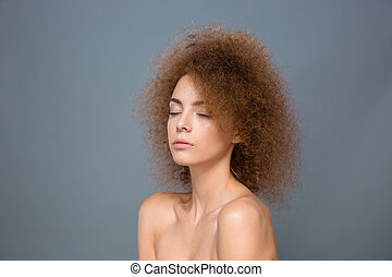Beauty portrait of young natural woman with voluminous curly...