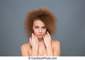 Portrait of tender natural woman with voluminous curly...