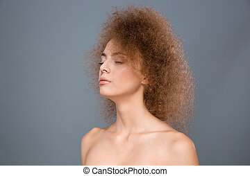 Closeup of young sensitive female with curly hair - Closeup...