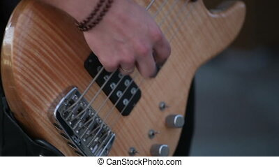 Musician playing guitar. Close-up