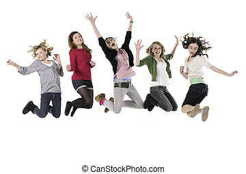 Jumping - Five teenage girls jumping in the air against...
