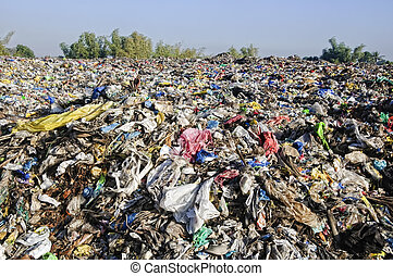 Landfill - A sea of garbage starts to invade and destroy a...