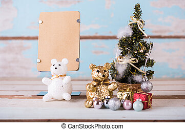 Cute teddy bears and christmas decorations with brown paper...