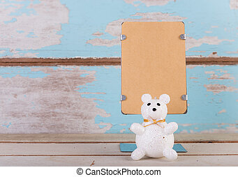 Blank brown paper stand and cute bear for text on grunge...