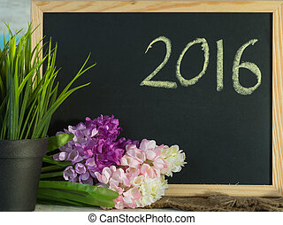 2016 wrote on blackboard decorative with artificial flower...