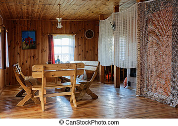 Interior in wooden rural tourist hotel - VILNIUS, LITHUANIA...