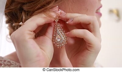 Hands of the bride dress beautiful earring Ukraine