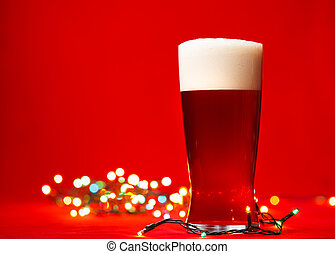 Christmas beer - Full glass of bear or ale with christmas...
