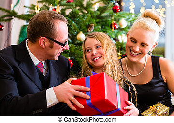 Family with Christmas gifts on boxing day - Parents and...