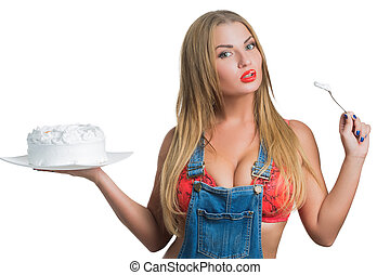 Busty sexy girl eating cake with whipped cream. white...