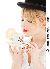 cup of tea - bright picture of lovely girl with cup of tea