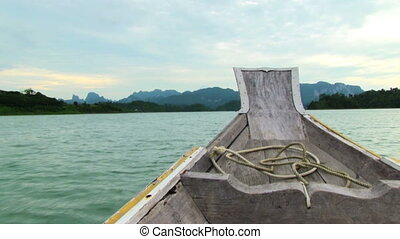 Wooden Boat In Tropical Sea - The wooden boat floating in...