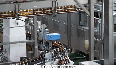 water bottles on conveyor or water bottling machine -...