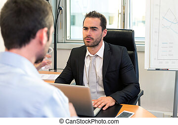 Attractive boss doing interview with his assistant - View of...