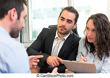 Attractive boss doing interview with his assistant