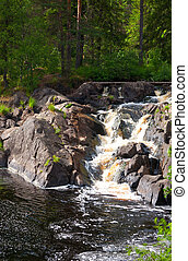 A small waterfall in the forest, Karelia, Russia