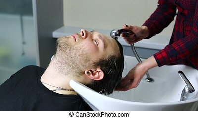 young man at the hairdresser - The young man at the...