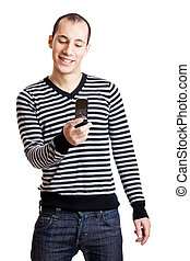 Sending an sms - Happy young guy sending a text message,...
