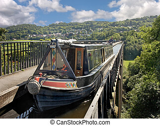 Crossing the Aqueduct - A narrowboat crossing the 120 foot...
