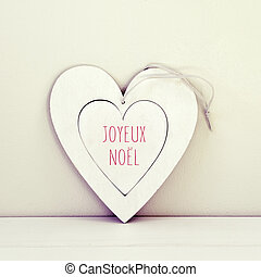 text joyeux noel, merry christmas in french - a white...