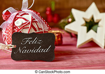 text feliz navidad, merry christmas in spanish - a black...